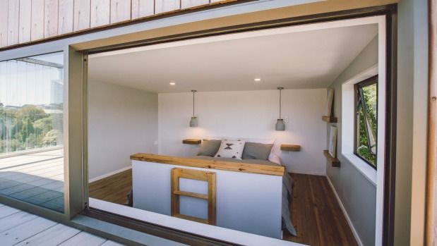 The loft bedroom opens right up to the upper terrace. The couple say they will add a couple of steps for easy access.