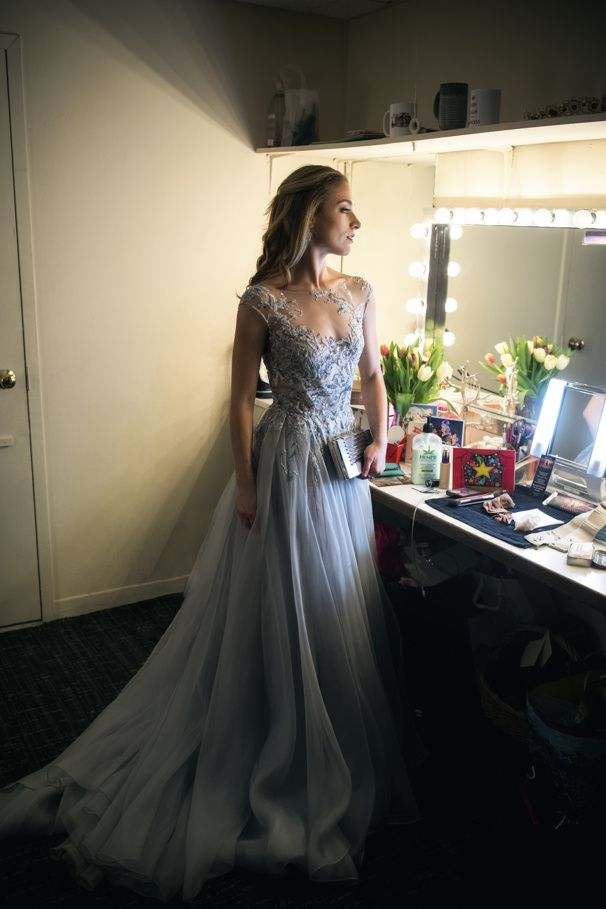 Photo of Heart don't fail us now! Christy Altomare is all smiles as she steps offstage after the opening night curtain call.