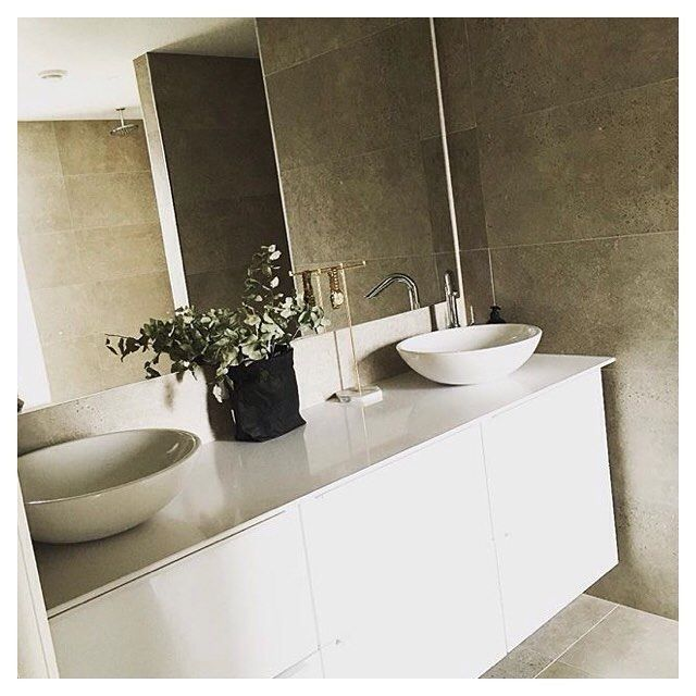 White composite worktop and a round porcelain wash basin to break up the…