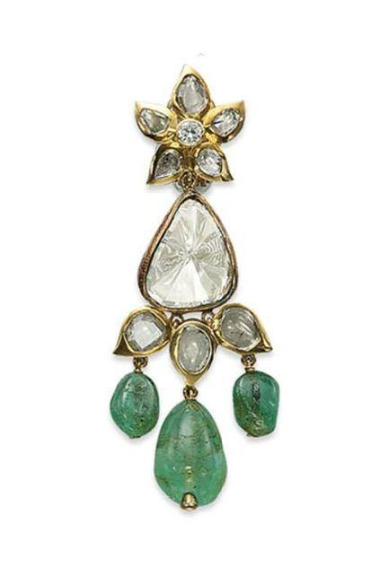 Emerald and diamond earrings by Mouawad.