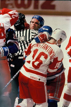 Tie is one of many in this brawl between the Leafs and Red Wings.