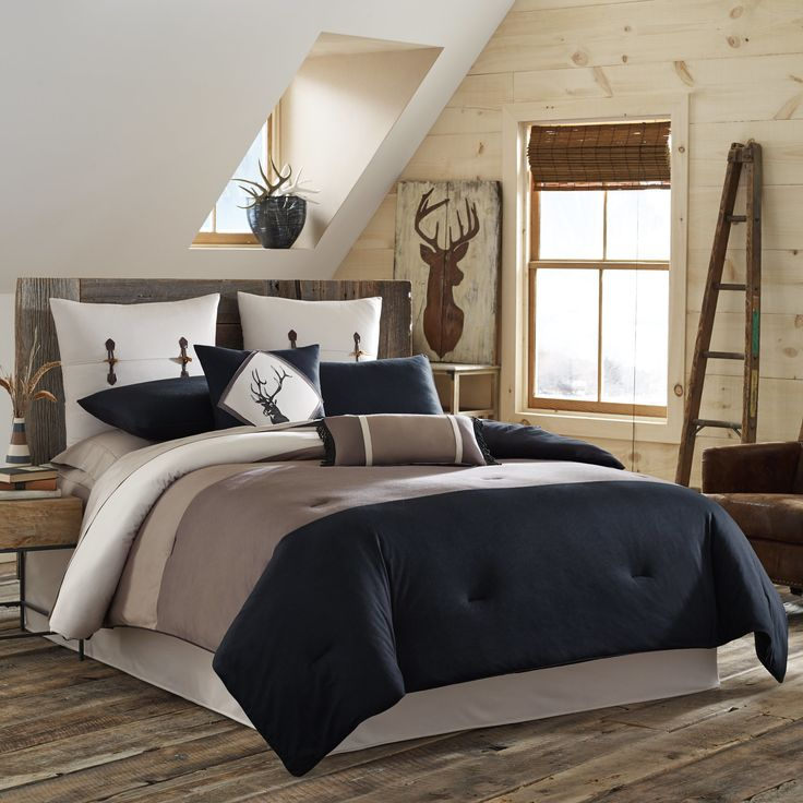 True Timber's Pieced Stripe Collection has the perfect rustic look for any bedroom. On the front of the tricot knit comforter, wide bands of brown, beige, and black create an earthy color blocking effect. The reverse side is solid.