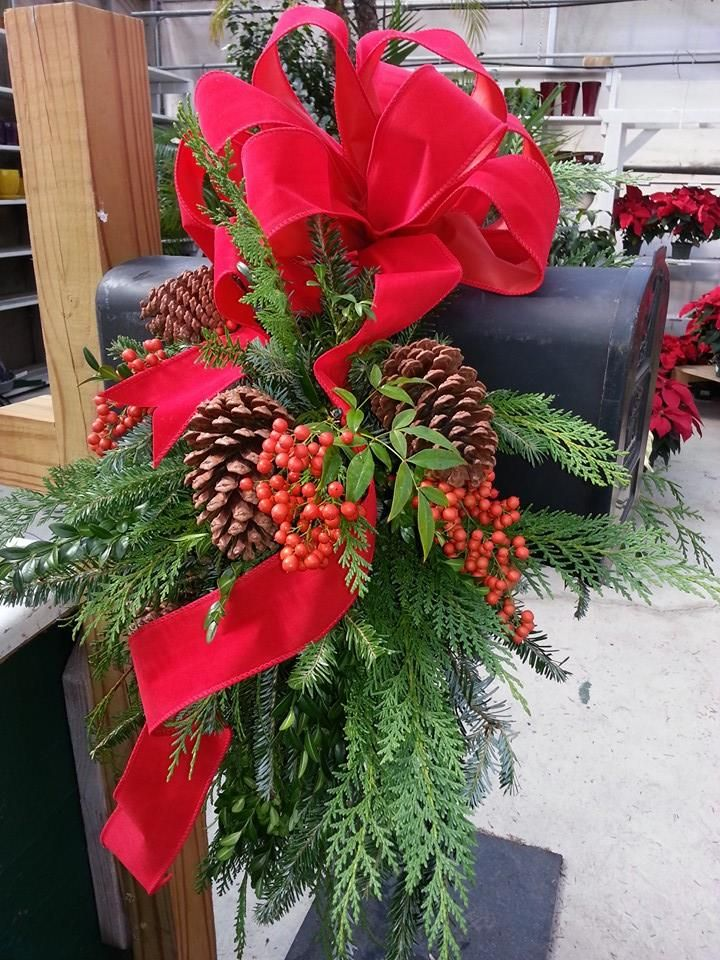 Traditional large mailbox saddle at Andy's Creekside Nursery in Vestavia Hills, AL. Mixed greenery - Frasier fir, cedar, boxwood, nandina berries pine cones and large red velvet bow.