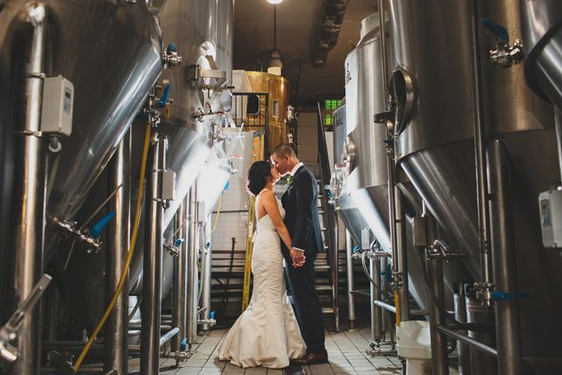This couple got married at Chicago's Revolution Brewery. Fun fact: it was a surprise to all their guests! The attendants did not know the couple was getting married!