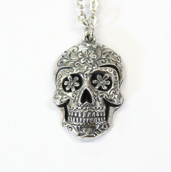 If you like your day of the Dead jewelry big and bold then this just may be the sugar skull for you. This large sugar skull pendant measures 1-1/2 long by