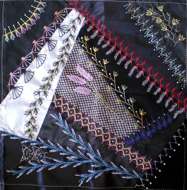 Black quilt embroidery. All blk fabrics on a crazy quilt. Striking. Would love to see the whole thing