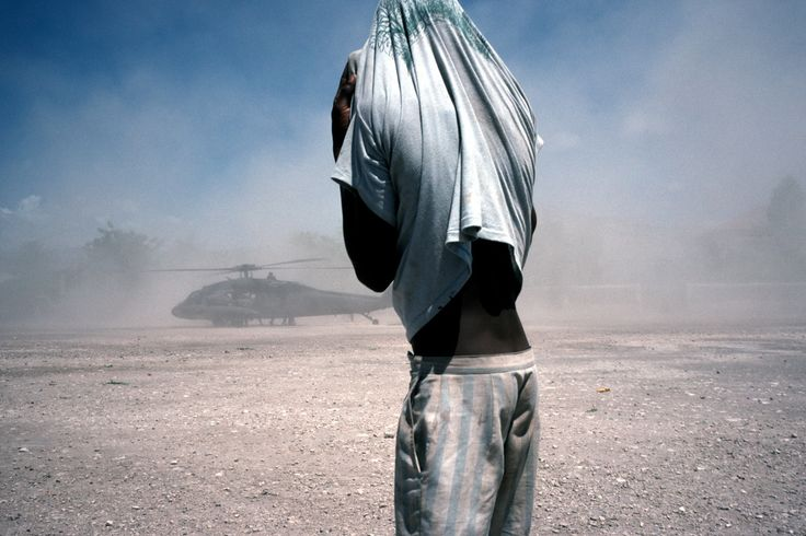 Alex Webb HAITI. Gonaives. 1994. A child watches the arrival of U.S. helicopters.