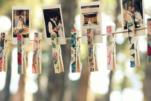 These floral pegs are such a cute way to display photos at a wedding! Image by Maria Panayiotou (CC-BY-ND).