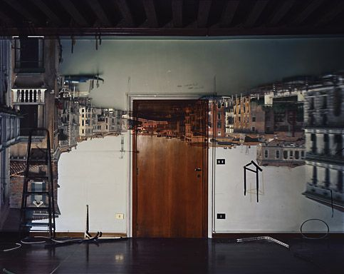 Camera Obscure with Abelardo Morell: He covered all his windows with black plastic in order to achieve total darkness, he then cut a small hole in the same black plastic material, an image of the outside scenery was reflected directly on the opposite wall, but it was upside-down.