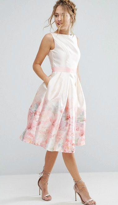 Pale pink dress with pastel floral hem detail. Beautiful dress for Spring, Easter or Rehearsal Dinner