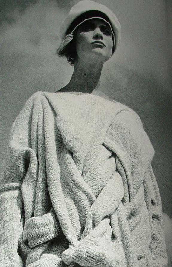 "Comme des Garcons Sweater, 1983, Model Unknown, Image Uncredited. Note: Comme des Garçons, written in Japanese as コム・デ・ギャルソン (Komu de Gyaruson), is French for ""Like Boys"", and is a Japanese fashion label headed by Rei Kawakubo, who owns the company with her husband Adrian Joffe. http://en.wikipedia.org/wiki/Comme_des_Gar%C3%A7ons"