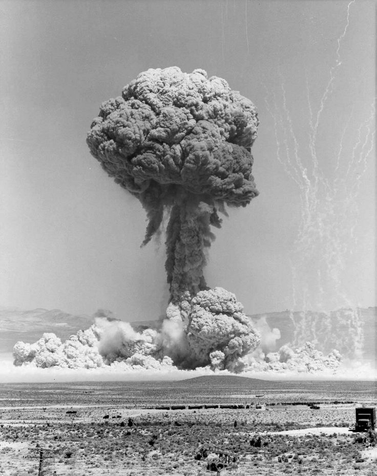 Atomic bomb explosion. It's actually a very beautiful image for such a destructive icon. The shape is soft, the colours are bright and neutral, the tendrils on the left seem delicate and gentle. Without any time perspective, it seems like it could be slow rising smoke that could be dispersed with the wind.
