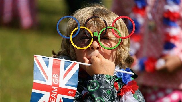 A young fan shows thier Olympic spirit. Olympics Olympics