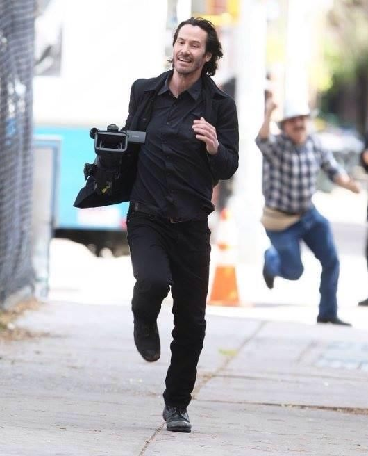 Just plain Awesome - Keanu Reeves running off with a camera he just stole from the paparazzi