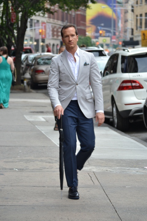 Light gray blazer and white button down with dark blue dress pants and black shoes with blue ...