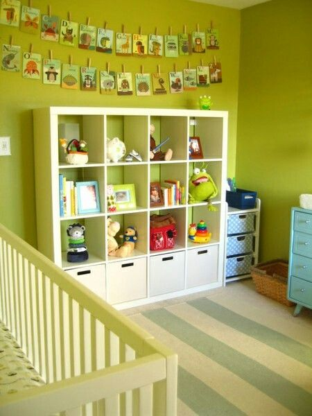 More storage ideas. 4x4 cube cubby shelf from ikea or Target. Those ABC cards hung from clothespins is an awesome idea