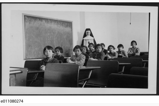 Children and a nun at Cross Lake Indian Residential School in Manitoba, 1940.