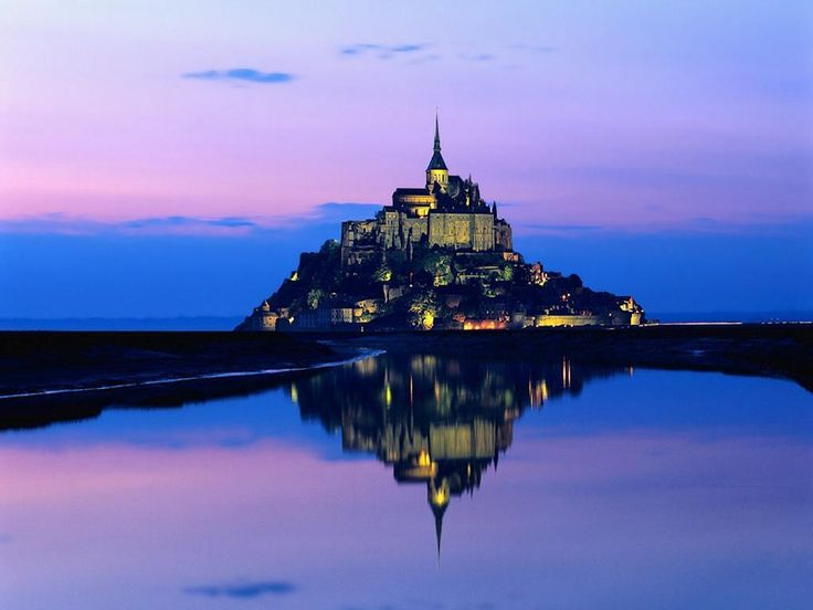 Mont Saint Michel in Normandy France. Town with an Abbey built on top of an island...when the tide is out you can walk to it. When the tide is in you cannot. So beautiful and amazing!