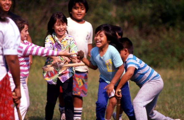 Seminole children playing stick ball: Big Cypress Reservation, Florida | by State Library and Archives of Florida. 1989