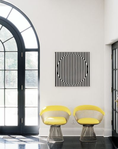 a pair of yellow chairs