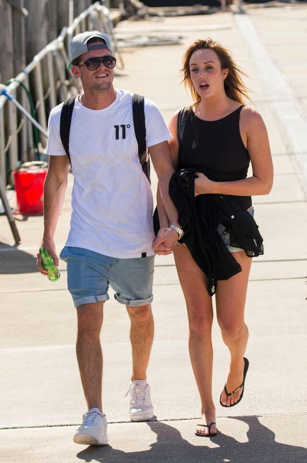 Charlotte and Gary hold hands on a recent trip to Australia - but have they fallen out now?