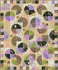 """Adalynn's Garden Quilt Pattern. Twin size quilt.  Super simple curved cutting with the 7"""" Crazy Curves template (sold separately) and quick curved sewing. It really is easy. Includes instructions to adjust this quilt to make it queen size.  Additional optional border included using the 3 1/2"""" Small Paths template (sold separately). 63"""" x 77"""". http://www.kayewood.com/item/Adalynn_s_Garden_Pattern/1889 $9.00"""