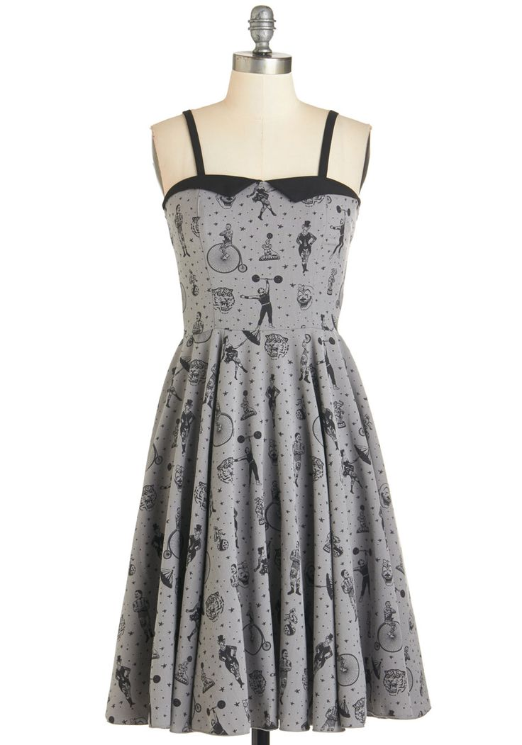 Clowning Around Dress in Smoke. Tigers, tattoos, and unicycling characters - you can find them all printed on this grey A-line dress! #grey #modcloth