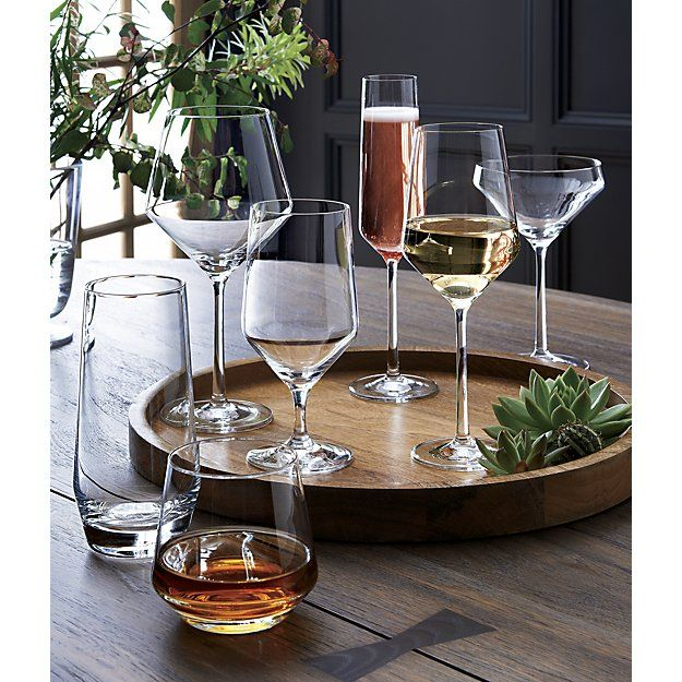 Shop Wood Round Serving Tray. Flat serving circle framed by a chunky rim leverages understated design to showcase the rich grain and dark-to-light shadings of mango, a highly sustainable tropical hardwood.