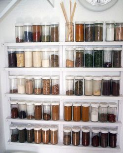 Build this quick and easy simple spice rack cheaply.  Empty jars can be purchased from the Container Store and many other places.  I'd like to make a racks like this for bead storage  and mount them along the wall behind craft table. Easy to see, easy to reach.  Digging around looking for particular beads drives me crazy.  There must be a better way.