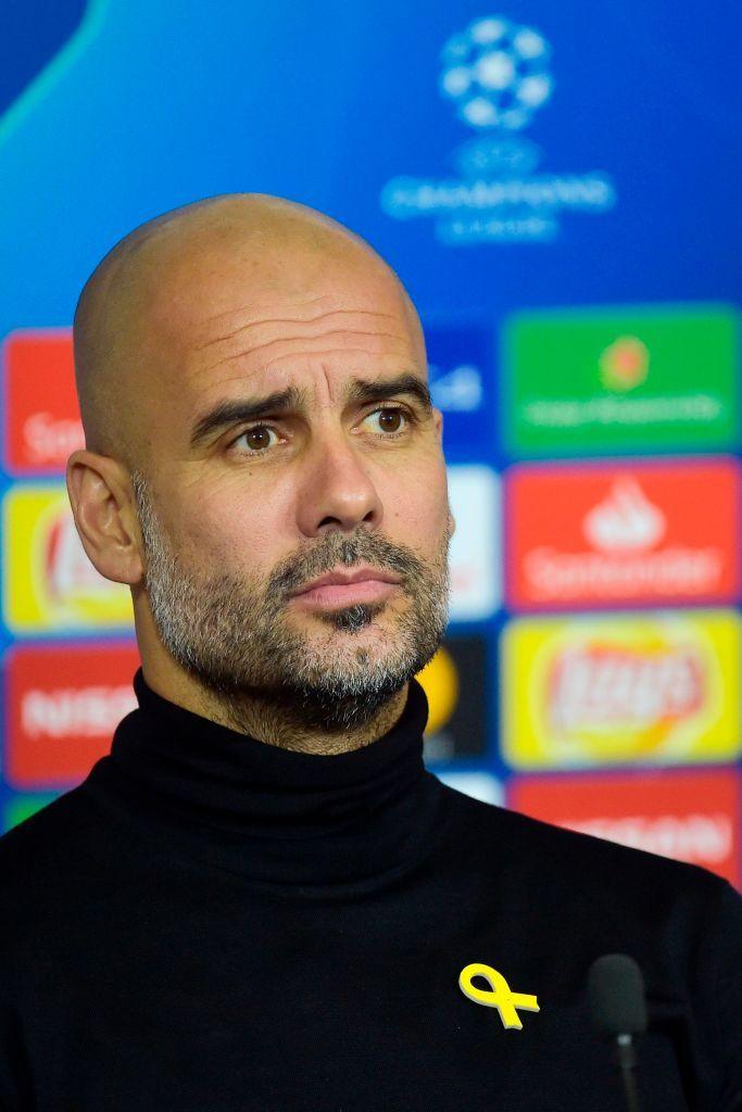 Manchester City's Spanish head coach Pep Guardiola looks ...