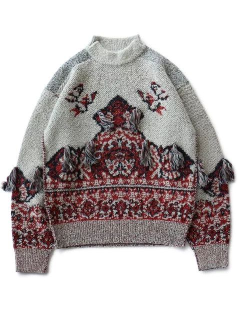 ジャガード織りのニットプルオーバーです。 やや高さのあるハイネックにはサイドにスリットが入ります。 ドロップショルダーでゆったりとしたシルエットです。  size3638 着丈63cm66cm 身幅102cm108cm 肩幅50cm53cm 袖丈58cm59cm  88% wool,10% rayon,2% nylon made in Japan  PRICE     ¥57,000  (+tax)