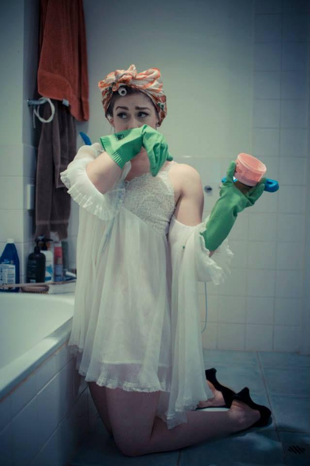 Leda cleaning the bathroom. Jocelen Janon Photography.