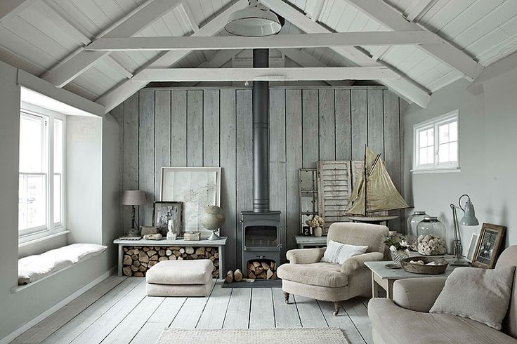 Hope House - Cornwall Wooden clad living room with log burner