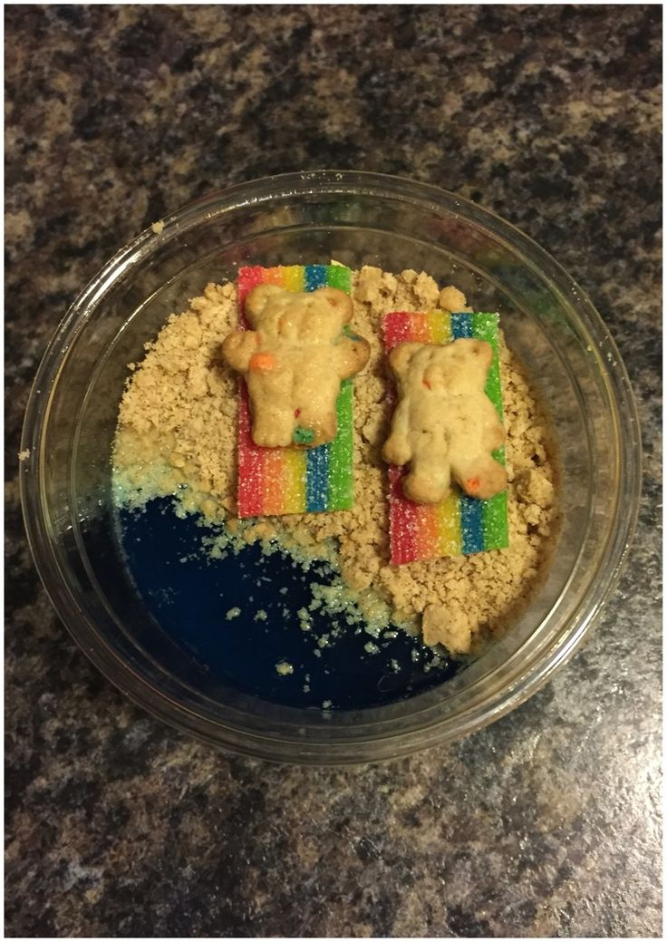 Cute Kids Reading Books- This ocean inspired treat is perfect for snack time. I first made blue jello and poured it into individual cups to setup. After the jello set I crushed graham crackers to make the sand and added the Airhead Extreme candy strips on top of the sand for a cute little beach towel toped with a sunbathing Teddy Graham. There you have it the cutest ocean snack ever!