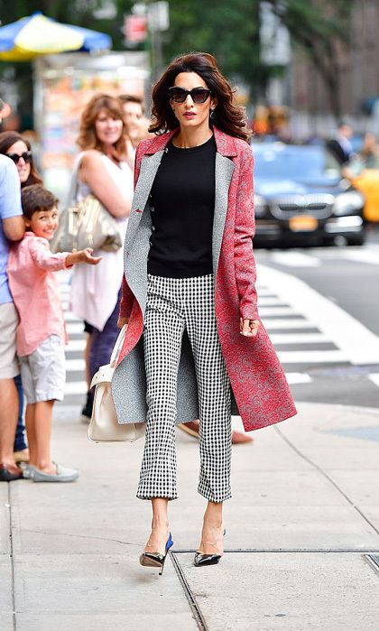 Amal Clooney is known for turning heads in Hollywood beside her husband George. However, the Lebanese beauty's stylish looks aren't just limited to the red carpet. The human rights attorney looks just as glamorous when she's in the courtroom or on the job. Here are some of her best work looks.  While in New York City to address the United Nations regarding ISIS' genocide, Amal took to the streets wearing a lace red Altuzarra coat and checkered pants paired with Giambattista Valli pumps.