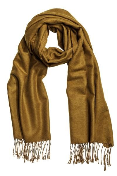 Woven scarf: Scarf in a soft weave with fringes on the short sides. Size 80x210 cm.