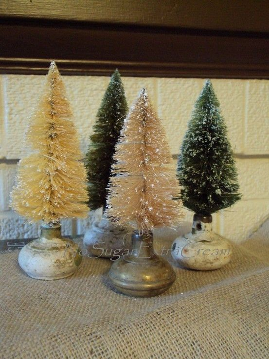 old door knobs as bottle brush tree stands. I love this but white trees are hard to find...