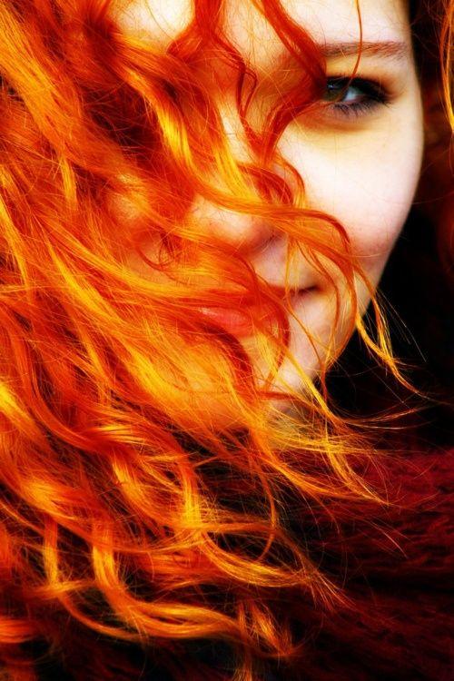 loose red curls