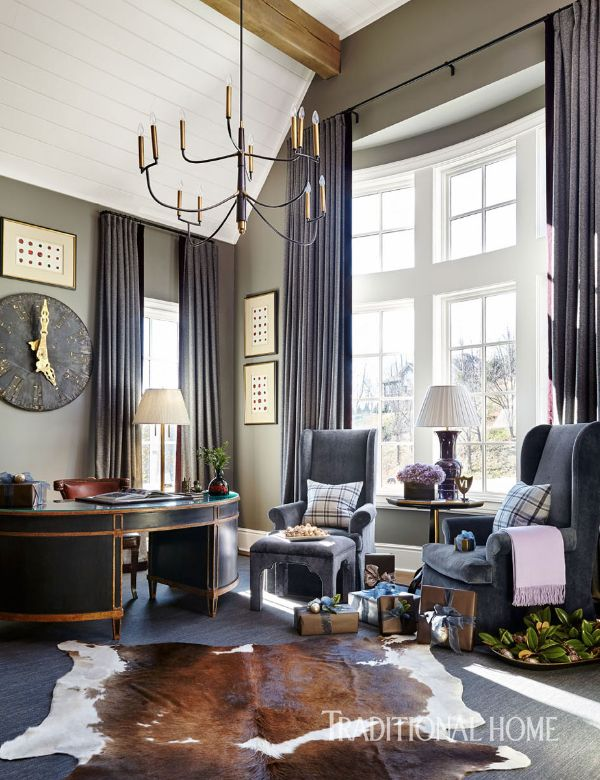 """A large antique clock, a chandelier from Circa Lighting, and walls painted Benjamin Moore's """"Rockport Gray"""" make the room cozy and approachable. - Photo: Emily Jenkins Followill / Design: Amy Morris"""
