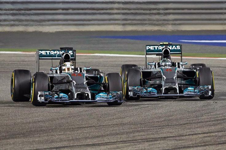 Lewis Hamilton battles his Mercedes team mate Nico Rosberg at Bahrain. Flashback to Fangio and Moss!