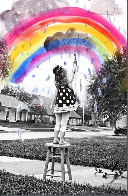 black and withe photography with girl paints the Rainbow. artistic photo