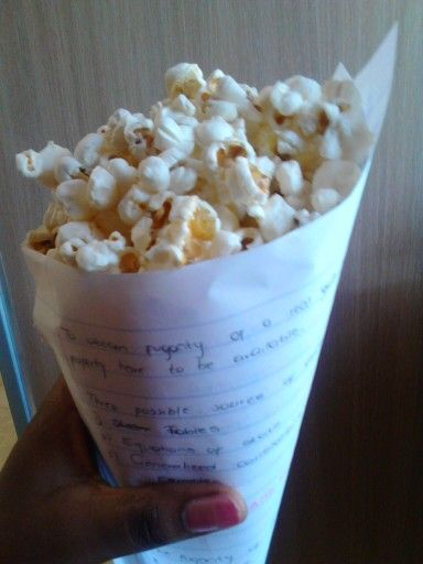 Reusing my class notes books to make pop-corn container.  This means i can enjoy my movie night plus no dishes after  Smart