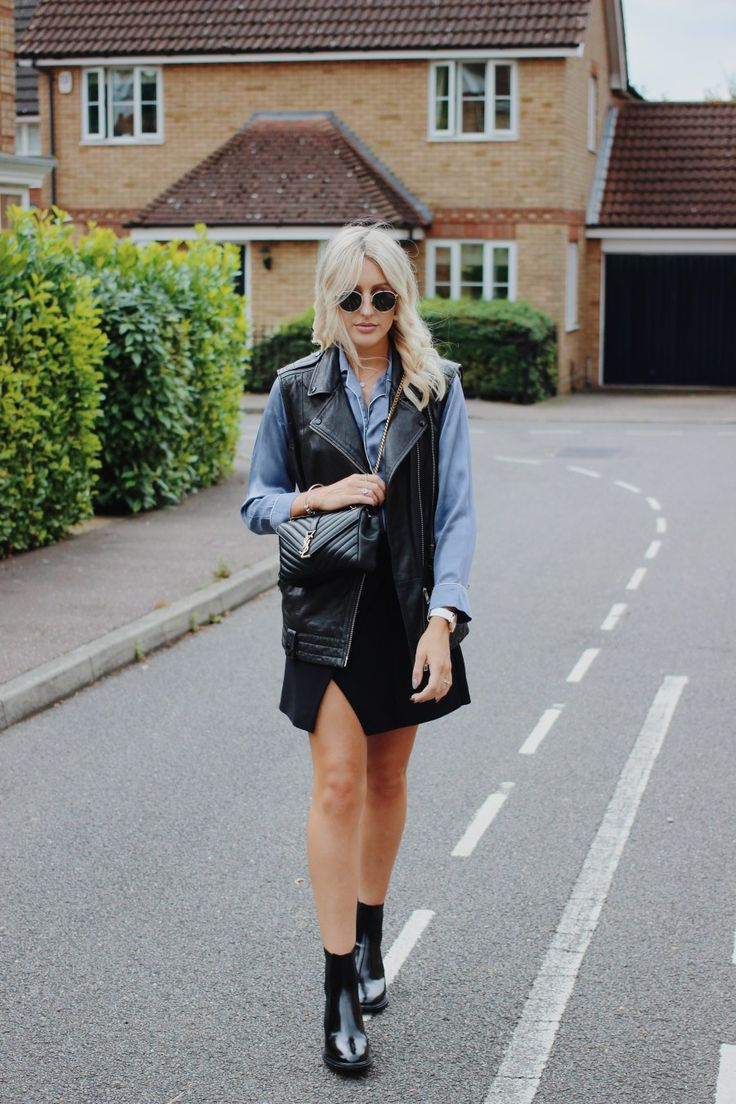 UK style blogger Charlotte Buttrick in Jil Sander boots, All Saints leather gilet, Whistles skirt, YSL bag and Rayban round sunglasses