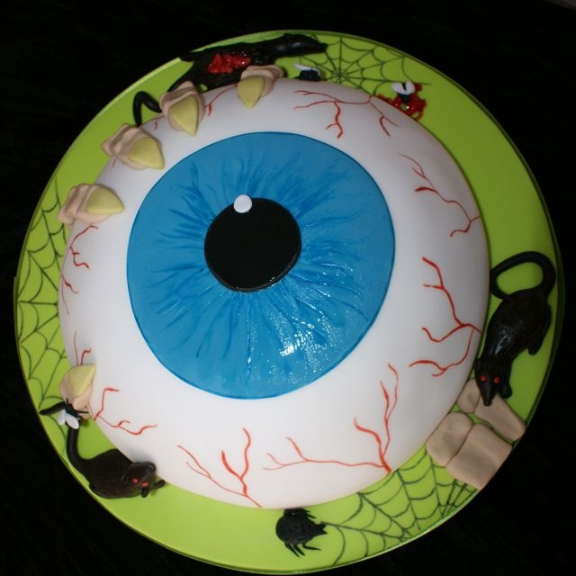 "eyeball cake | I made the entire eyeball using the ball cake pans. As an added ""bonus"", you can use sour stripes or licorice to the back for the optic nerve and various blood vessels."