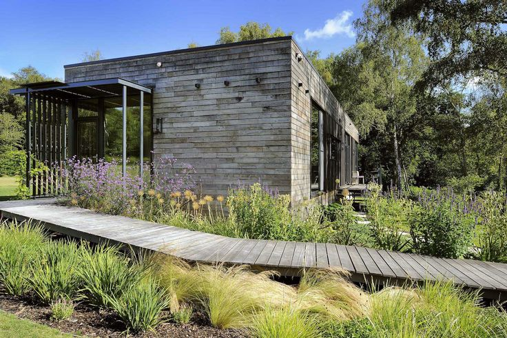 PassivHaus, Forest Lodge, Forest Lodge by PAD studio, PAD studio, air source heat pump, radiant heating system, triple glazed windows, photovoltaic array, prefab architecture, prefab housing, prefab, prefab house, mobile house, New Forest National Parkland, solar powered house, portable house