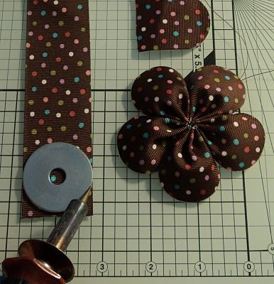 Use woodburning tool to cut and seal ribbon in one step (from Ribbon Flowers blog)-who da thunk?