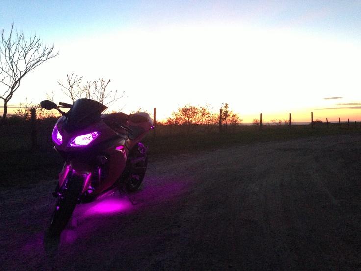 Pink 2013 Kawasaki Ninja 300 with LED under glow kit.