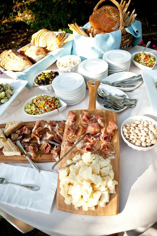 Rustic and easy buffet. Just pick up your favorite meats, cheeses and breads from your favorite deli or market, arrange and enjoy! What would yours include?