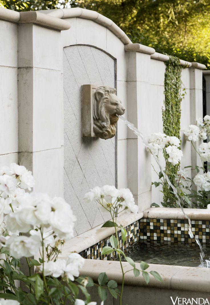 A lion's-head fountain and tiles by Ann Sacks animate a garden. - Veranda.com