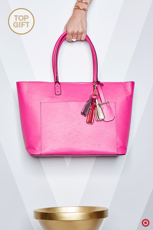 This Christmas, give your trendsetter friend (or… girlfriend, sister or mom) the gift of pure style with this tote from Who What Wear. This handbag features a bold, eye-catching hue that easily brightens up the winter blues. Designed with a spacious interior and unique texturing, this on-trend tote is a gift sure to surprise and delight any fashionista. Personalize this bag with a trio of tassels—they're super trendy and add a ton of fun.